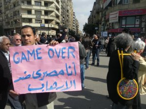 A Muslim Brotherhood activist in Tahrir Square. His sign reads: