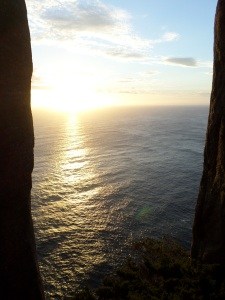 The sun setting between two dolerite columns at Cape Raoul isn't too shabby