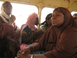 A Fulani woman, clad in a hijab, publicly breastfeeds in the back of a carte-carte. Islam (and its rules of modesty) are very syncretic in West Africa.