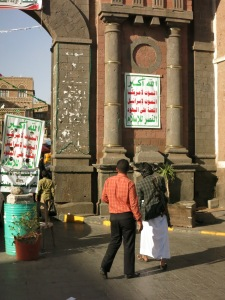 Houthi rebel in front of Bab Al-Yemen, seconds before I was told not to take photos of the gate because his banner was hanging on it.