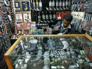 A jeweller selling the traditional jambiyya in a Sana'a souq.