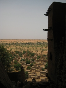 The view of the Dogon villages from high on the Bandiagara Escarpment. The previous inhabitants of the area - the Tellem Pygmy - built their domiciles high up in the cliffs crafting tiny doors and miniature windows as portholes looking over the rest of the world.