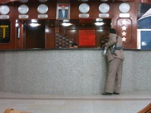 A Houthi militant checks in his Kalashnikov at the hotel lobby.