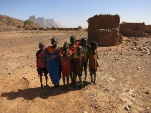 Children in Garmi pose for the camera