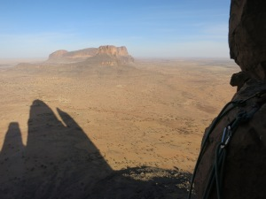 The shadow of the massif over Daari. The wall of the destroyed camp seen below.