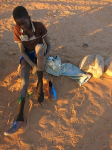 Plastic slippers donated by various aid group make for soccer boots in Garmi